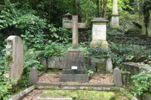 Mary Carpenters grave at Arnos Vale, grey stone cross on a plinth