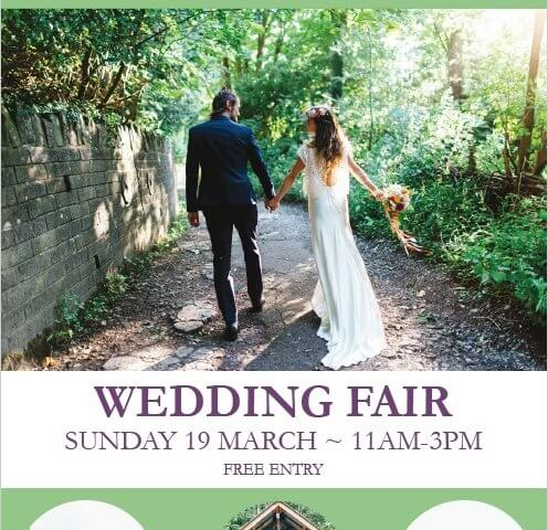 Wedding Fair poster for 19th March 2017, couple walking hand in hand up woodland path
