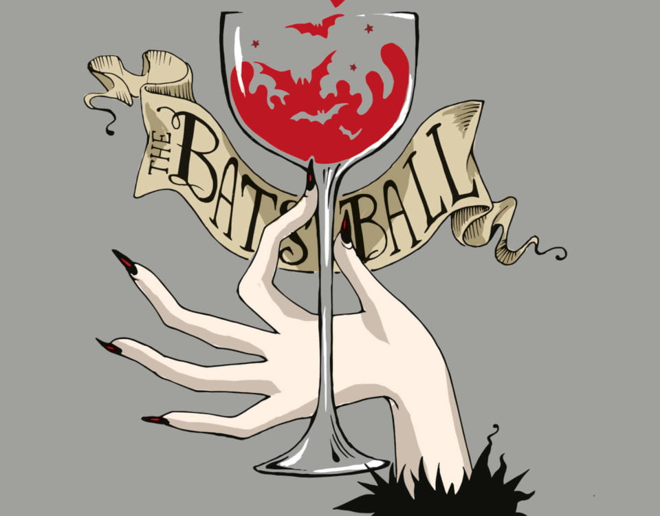gothic hand with long black nails holding wine glass with wine coloured bats flying out