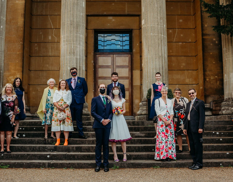 Wedding guests standing apart on the Spielman steps