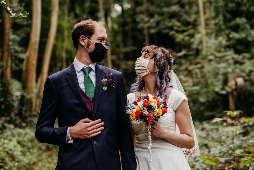 Couple wearing masks in the woods