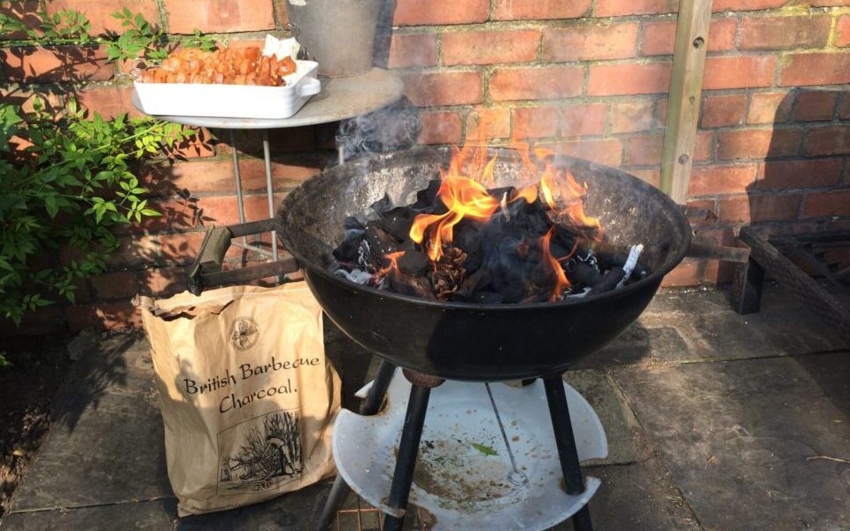 Charcoal burning in fire bowl