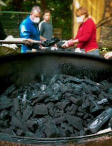 Volunteers loading bags of charcoal