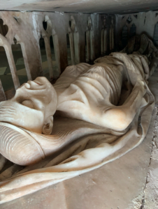 Human sculpture emacitated in death from top down in stone